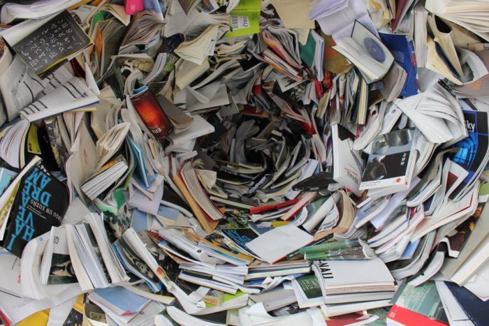 swirl of books and papers Giving Your House The Clear Out It Needs / Spring Cleaning Your House