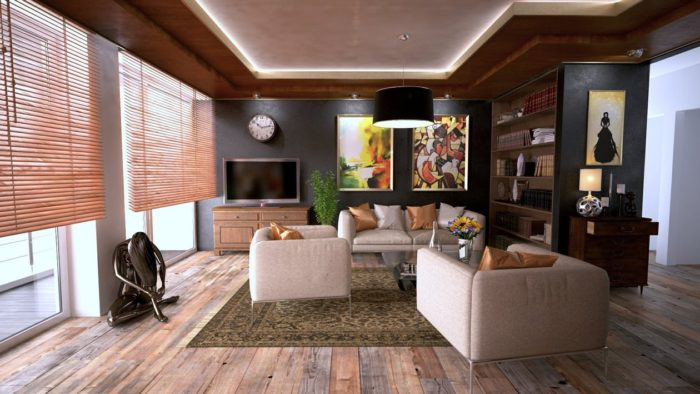 living room with hardwood floors nice built in bookcase couches what features make up an ideal home