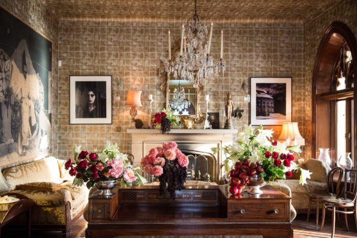antique living room full of antiques and flowers