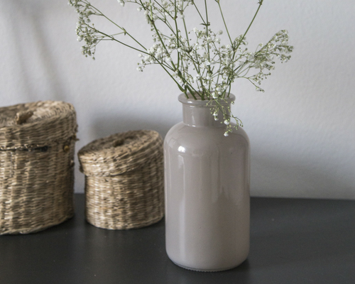 two wicker baskets with lids neutral vase with flowers Preparing your home for sale home staging