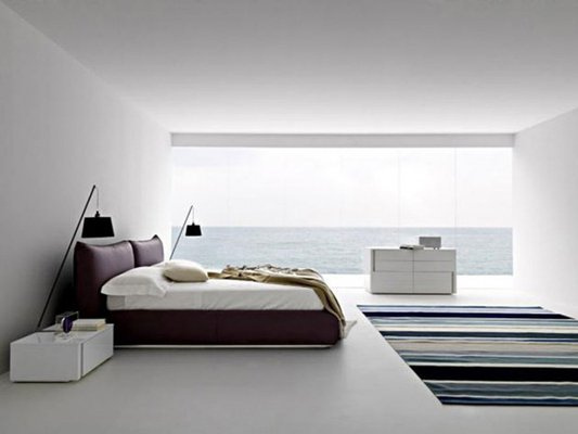 Everything You Need to Know About Carrying Out a Bedroom Makeover / Master Bedroom Makeover Ideas queen size bed large picture window nightstand pillow headboard white walls staging area rug