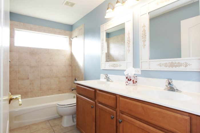 Scraping the Chafing with a Fixer-Upper Home / Scraping The Chafing To Make Lines Smoother In Fixing Up Your Fixer-Upper Home interior bathroom ceramic tile dual mirrors dual sinks tub toilet