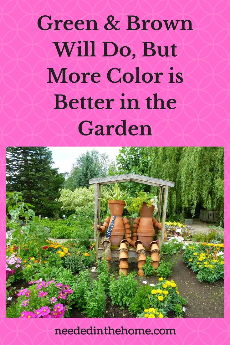 pot people man and woman sitting in wood structure in colorful flower vegetable garden Green & Brown Will Do, But More Color is Better In The Garden