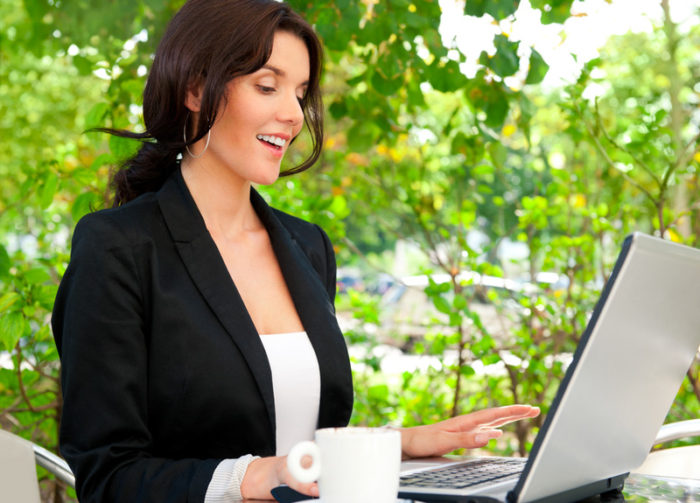 Happy family life / Corporate Strategies That Help Family Life woman at laptop outside greenery leaves coffee sitting smiling happy