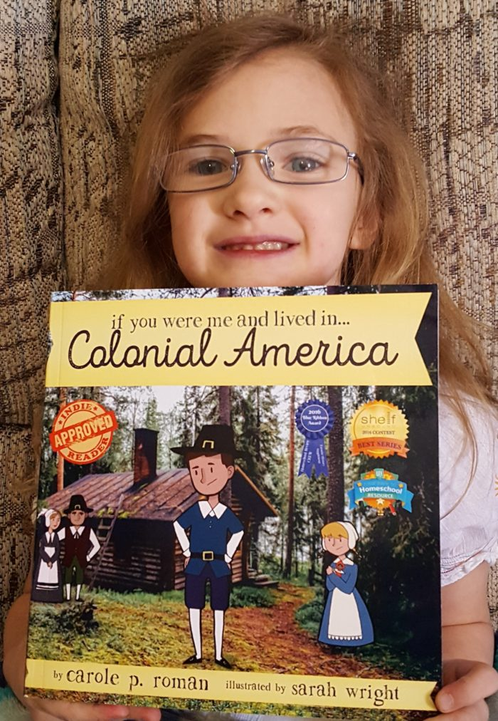 Product Review of If You Were Me And Lived In Colonial America paperback book by Carole P. Roman blond girl wearing glasses holding book