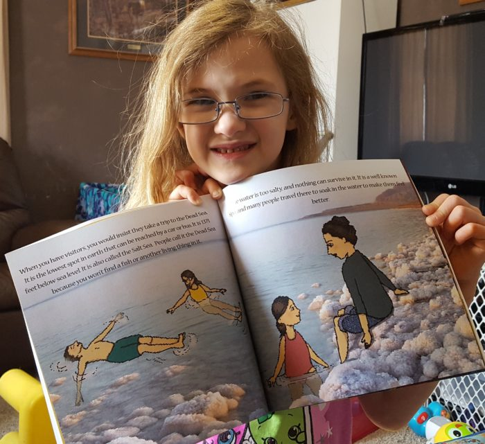 Product Review of If You Were Me And Lived In Israel paperback book by Carole P. Roman blond girl wearing glasses holding book