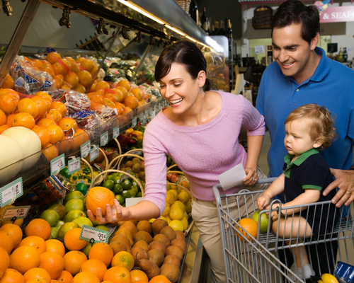 What can you gain or lose in a dual-income family? a family shopping at a grocery store