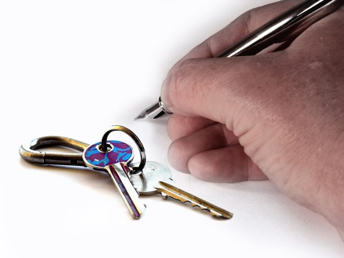 Avoiding rental rip offs keys signing lease rental contract hand and pen