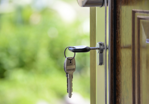 keys in lock of house door change the locks when you get into your new home for safety