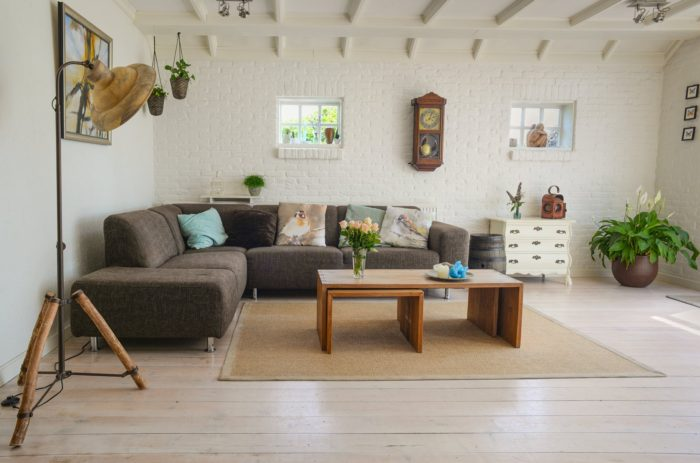 perfect location for your new home large living room couch pillows plants lighting coffee table