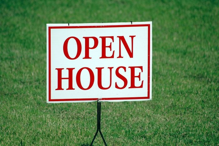 Open House sign on grass lawn how to get ready for a house showing to sell your house within days instead of months
