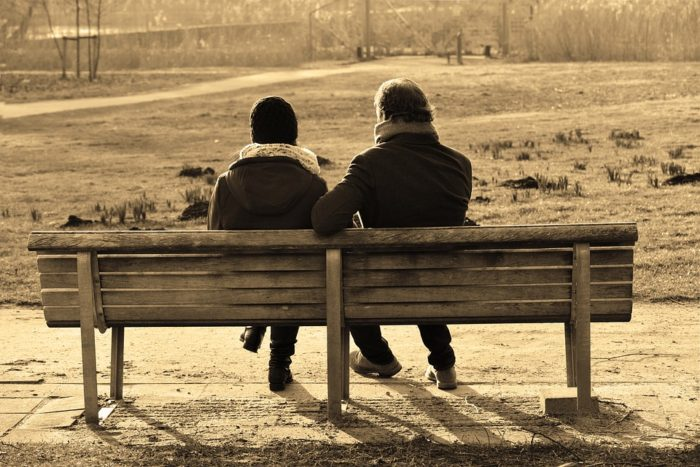 Get money help and manage your money so you don't end up on a park bench with your spouse man woman bench