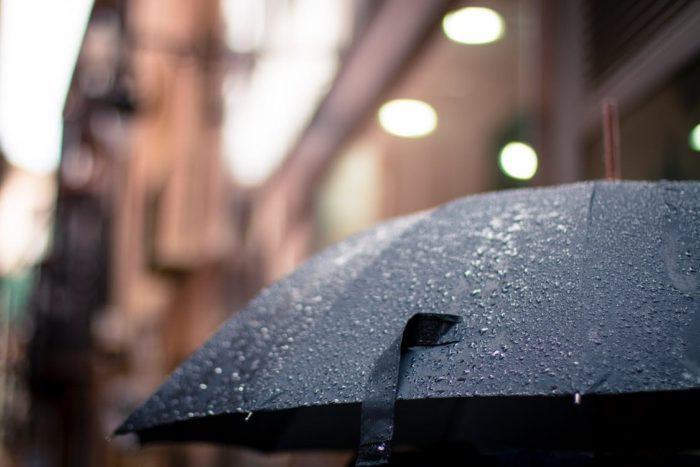 Ways to Keep your home safe from thunderstorms umbrella in rain