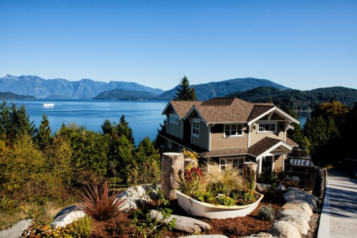 Moving to the perfect location mountain lake view home wooded two story house