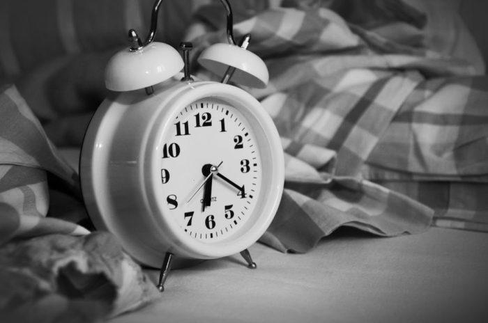 Can't Sleep Alarm Clock blankets black and white photo