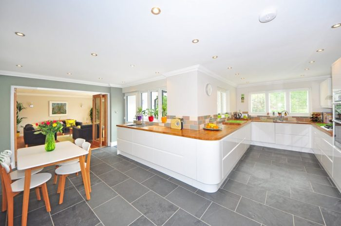 Kitchen Decor and Upkeep dining room table and chairs long counters open concept kitchen sink windows