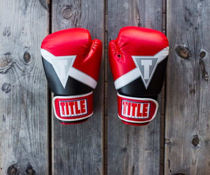 Fighting Back When You're Forced Out Of Work boxing gloves labeled title