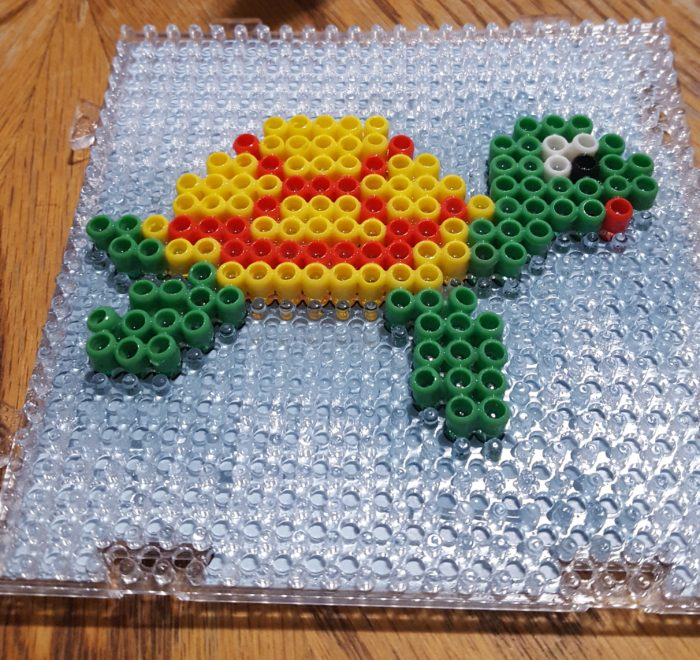 Product Review of Zirrly Super Beads from the Mega Pack using the Turtle Design Template and board after sprayed with water