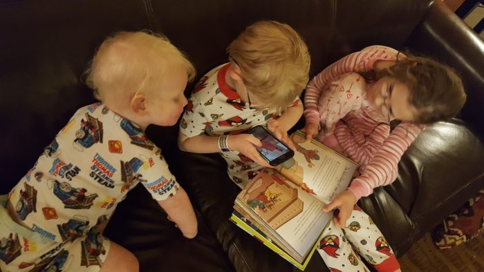 Planet 316 Story Bible and App being used by three small children