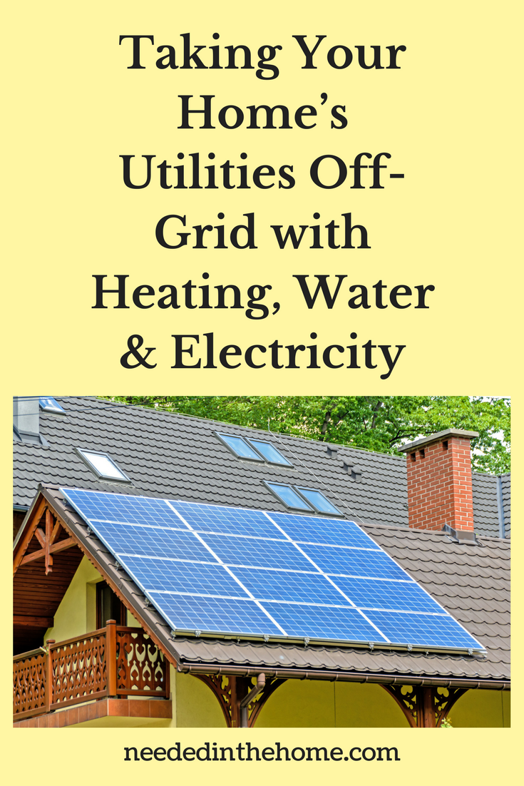 Off-Grid / Taking Your Home's Utilities Off-Grid with Heating, Water & Electricity / solar panels on the roof of a house near fireplace chimney neededinthehome