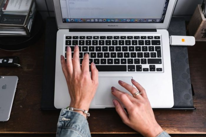 home business hands typing on laptop keypad