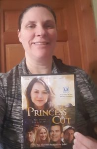 Product Review of Princess Cut movie by Watchman Pictures DVD Blogger woman holding the physical DVD
