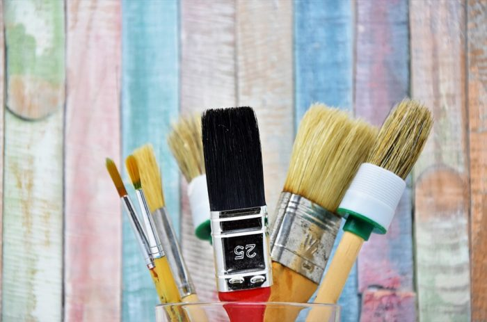 Home Improvement tasks that take longer paintbrushes in a glass jar