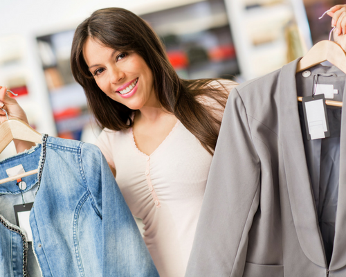 Reducing your costs woman considering a purchase of a fashion wardrobe
