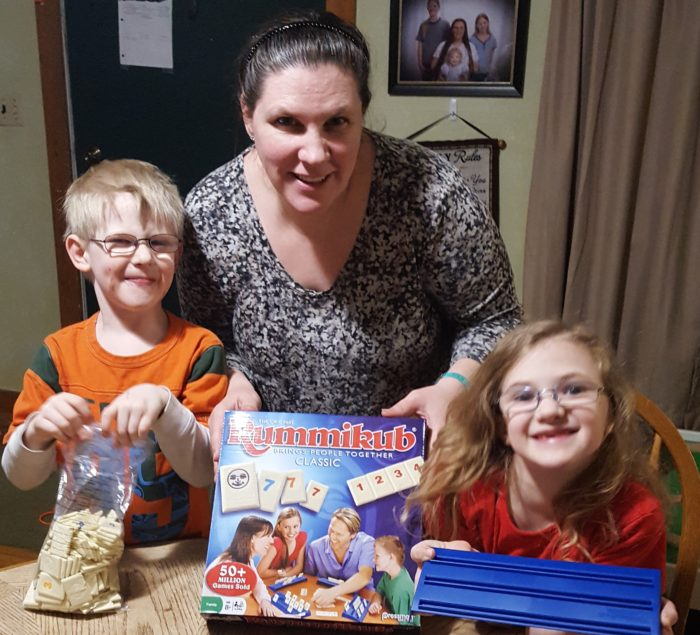 review of Goliath Games Rummikub mother and children getting ready to play and review Rummikub