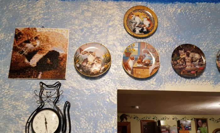 Completed 3D art cat and kittens picture made of Photo Pearls from Goliath Games hanging on wall near cat plates cat clock