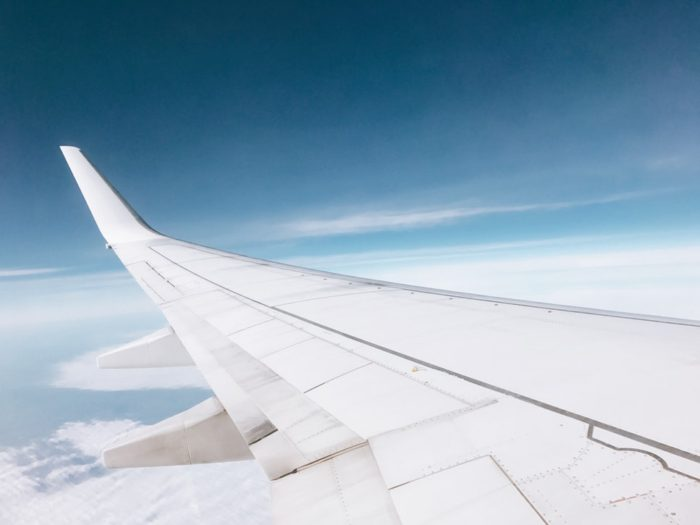 Moving your family abroad looking at the airplane's wing