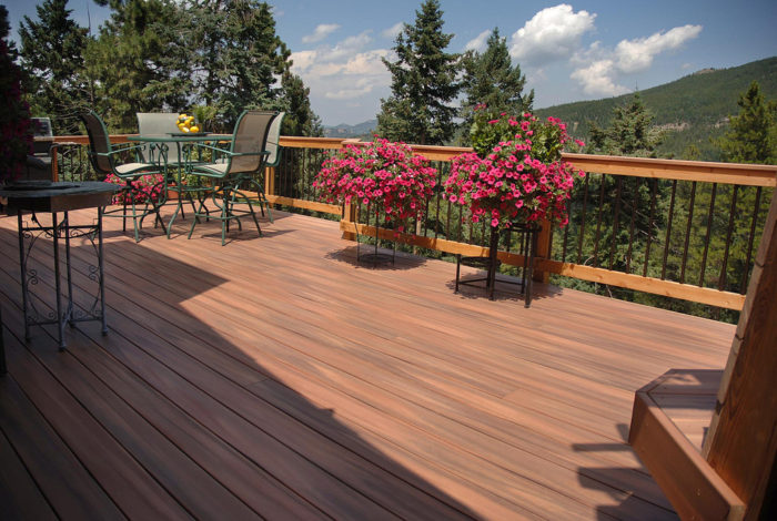 Home into a paradise with a new deck image decking plants flowers outdoor seating