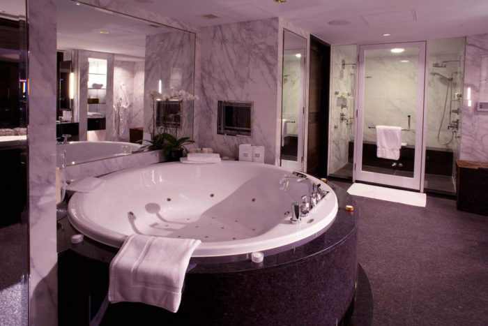 Home into a paradise image en suite jacuzzi tub mirrors master bathroom