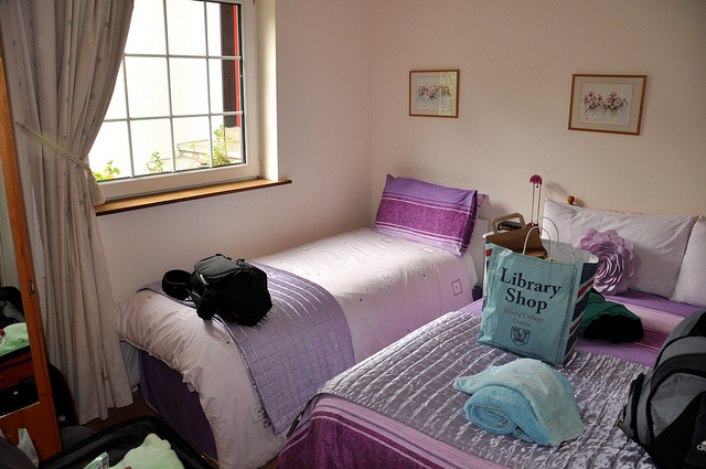 The Ultimate B&B image full size and single bed in bedroom at a local bed and breakfast