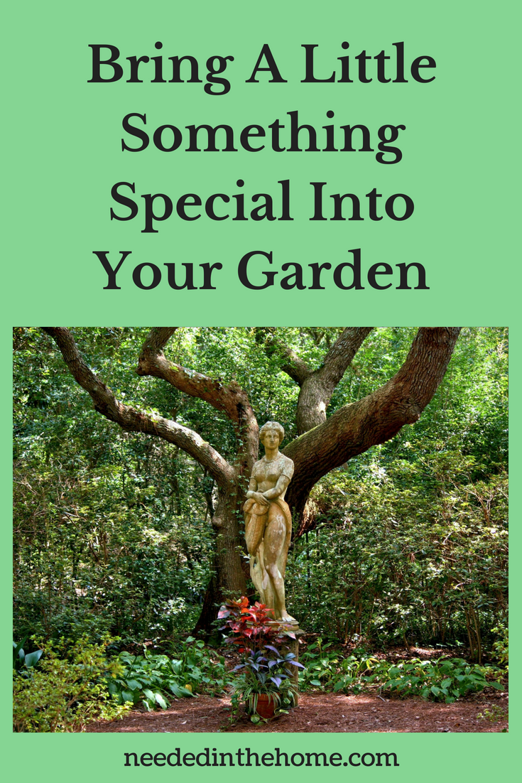 Bring A Little Something Special Into Your Garden image centerpiece tree with statue and flowers neededinthehome