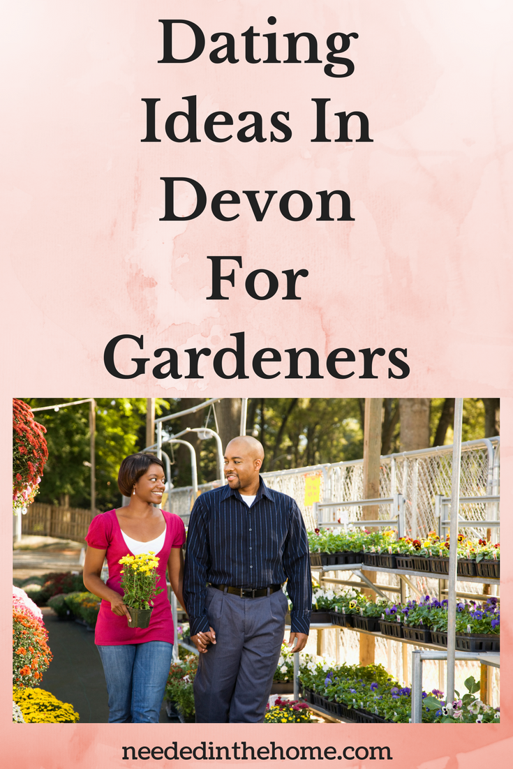 Dating Ideas In Devon For Gardeners image of couple walking in a greenhouse holding hands choosing plant on a date flowers around them neededinthehome