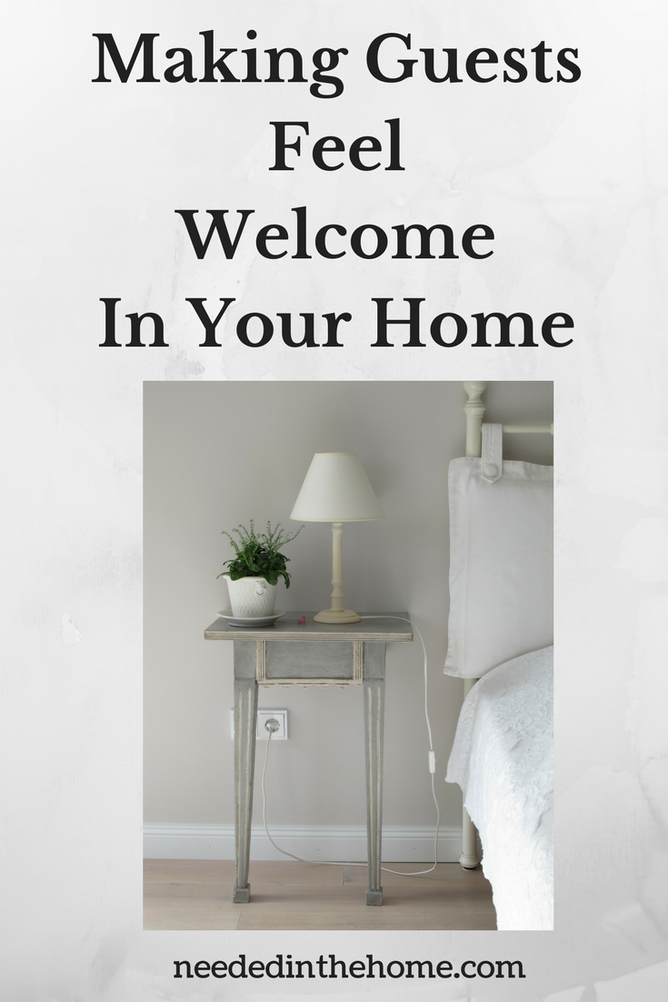 Making Guests Feel Welcome In Your Home image of guest room with bed pillow side table lamp plant neededinthehome