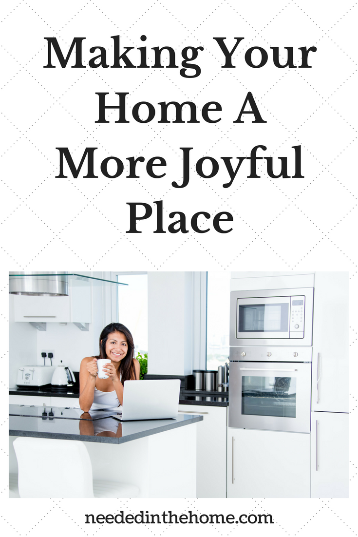 Making Your Home A More Joyful Place To Be image woman smiling with coffee and laptop at kitchen counter neededinthehome