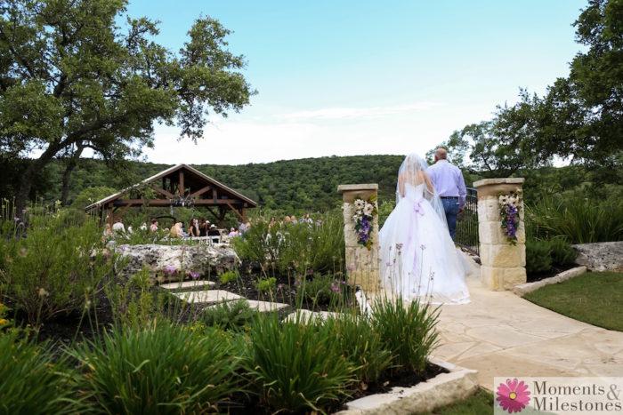 Bella Springs Wedding Venue bride and father of the bride walking the path