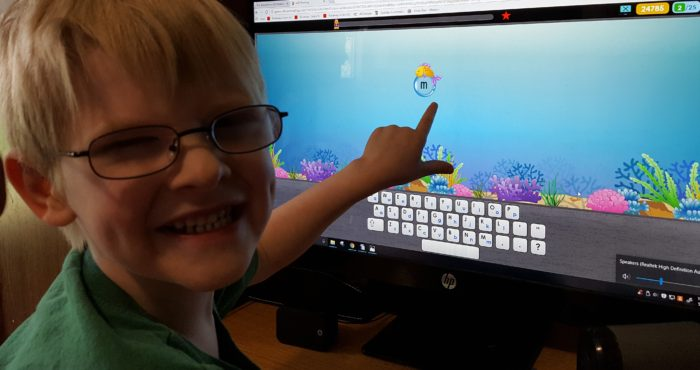 Review of ASD Reading boy wearing glasses who has borderline Asperger's using autism reading program on computer