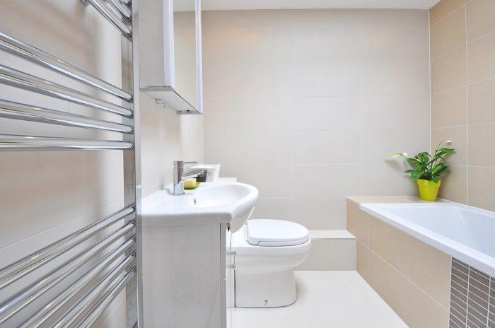 Bathroom Renovation DIY image bathroom interior white sink toilet counter tub heated towel rack