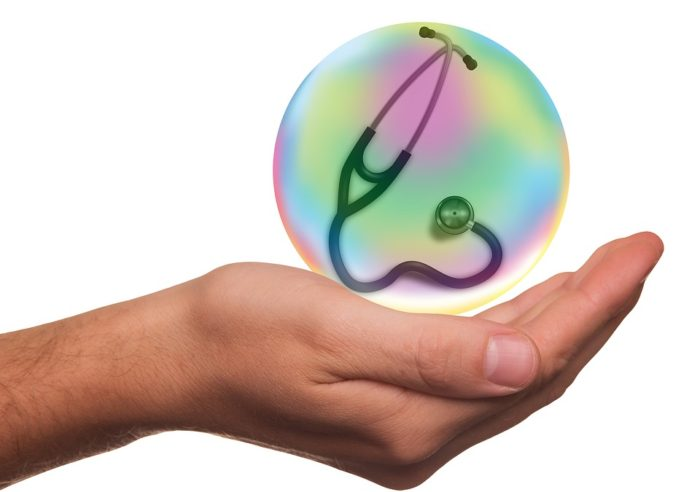Insurance coverage - Health Insurance Medical Insurance image hand holding bubble with stethoscope inside indicating how fragile our health is
