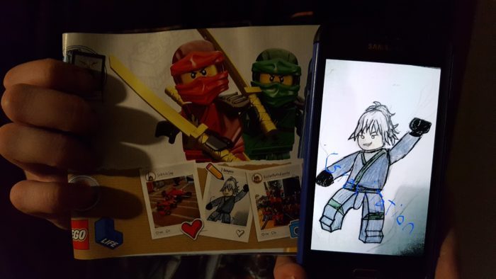Original Character art sent on Smartphone becomes art in Lego Instruction Manual
