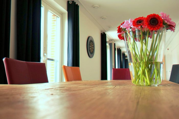 Revitalize your home image glass vase of colorful flowers on dining room table