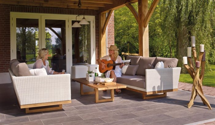 Creating a garden room in your backyard patio deck area image of women playing guitar sunhat sofas lighting french doors