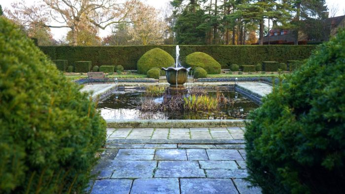 Something Special Into Your Garden image waterfall with pond in center of garden area