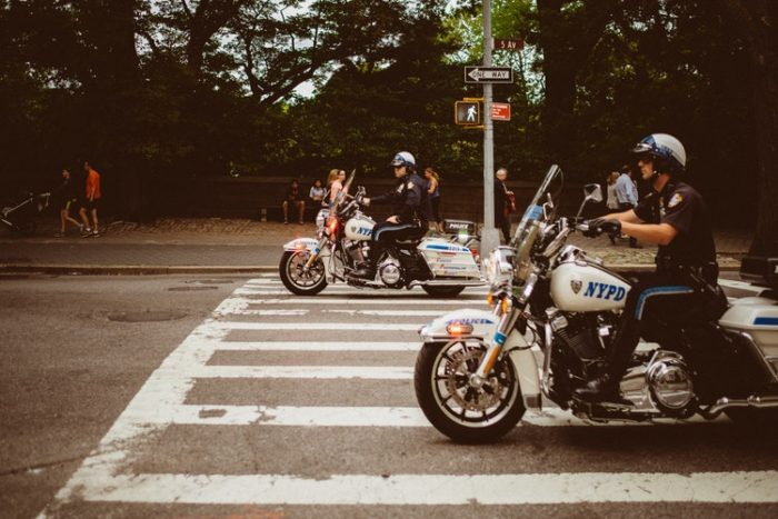 Traffic Laws you may be violating image policemen on motorcycles driving