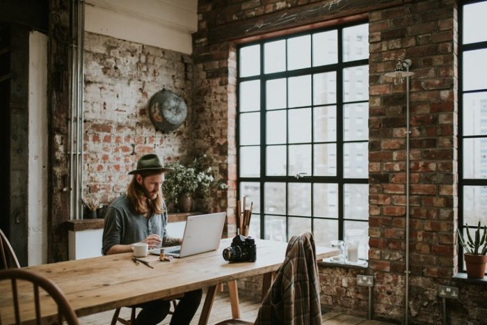 Skills Every Work from home solopreneur needs man sitting at a table with laptop