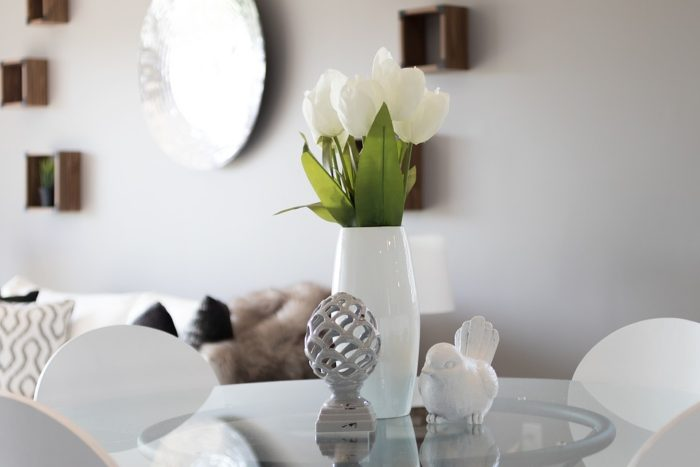 Staging Your Home image living room table display three items flowers statues neutral colors