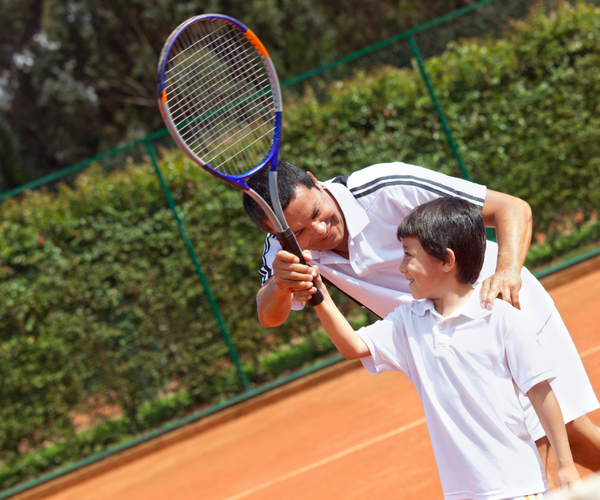Health and Wellness Home Business image Tennis Coach and student with tennis racket